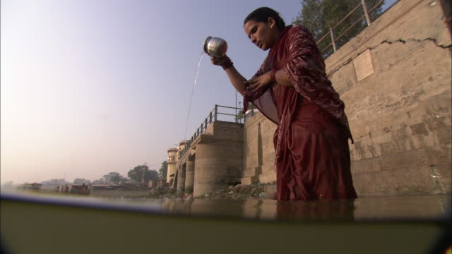 men and women perform ablutions in a canal at the base of a temple in diwali, india. - canal stock videos & royalty-free footage