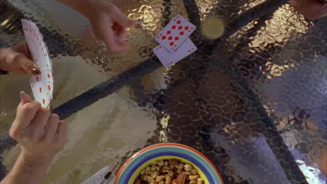 cu cs men and women playing cards / canyon lake, texas, usa - canyon lake stock videos & royalty-free footage