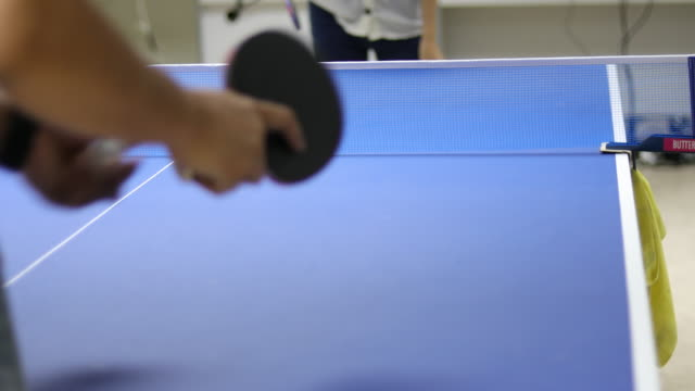 men and women playing table tennis. - table tennis stock videos & royalty-free footage