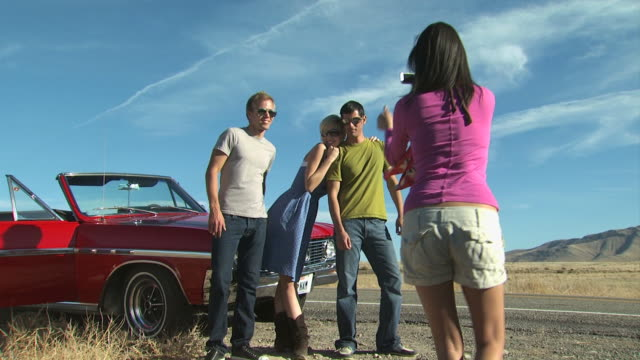 men and women posing on the side of the road - see other clips from this shoot 1138 stock videos and b-roll footage