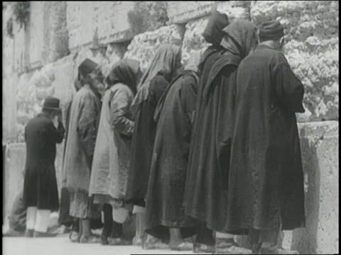 men and women pray and kiss the wailing wall in jerusalem - wailing wall stock videos & royalty-free footage