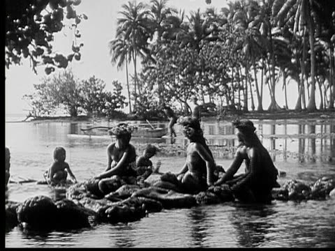 1934 b/w ws men and women running off while one man pushes canoe into water / hawaii, usa - hawaiian culture stock videos & royalty-free footage