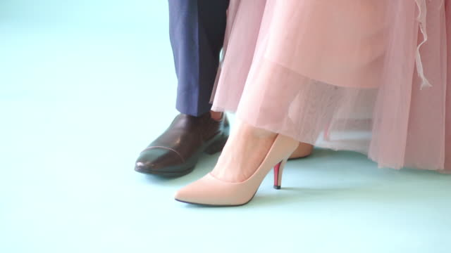 men and women shoes at the blue screen. - scarpe video stock e b–roll