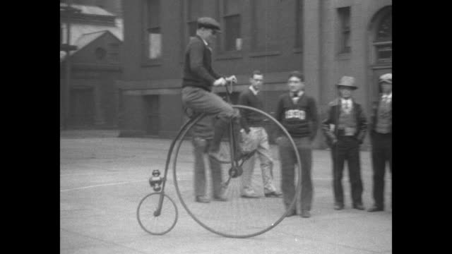 men and women standing with various types of bicycles / man riding highwheel bicycle / couple riding sidebyside bicycle / man riding bouncing bike /... - 1920 stock videos & royalty-free footage