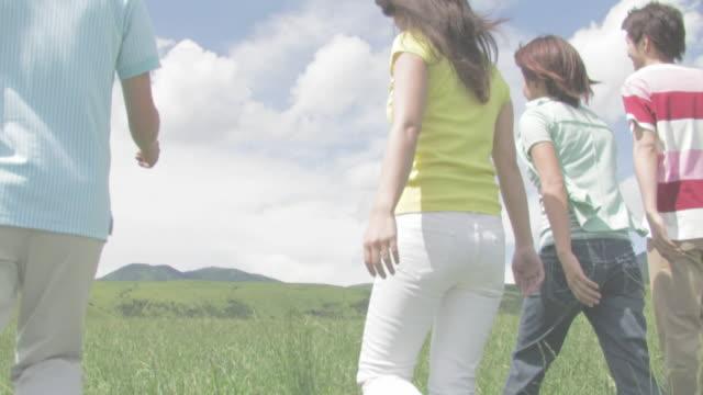 Men and women walking in green