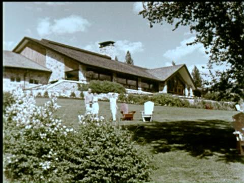 WS Men and women walking on lawn at Jasper Lodge / AUDIO