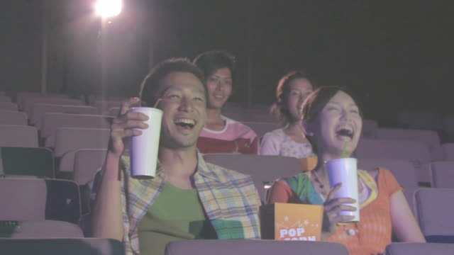 men and women watching movie in theater - デート点の映像素材/bロール