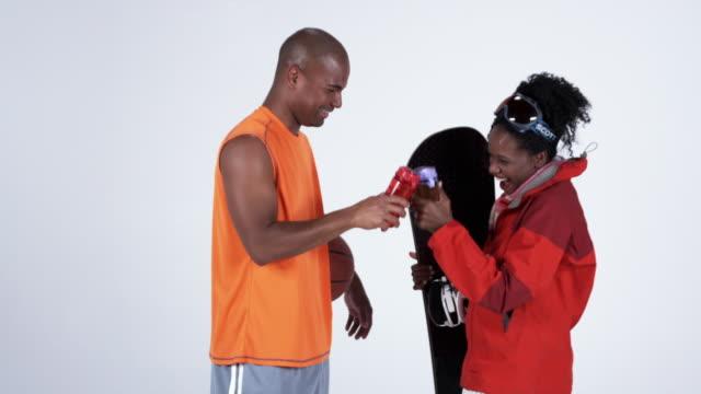 ms men and women with basketball and snowboard / orem, utah, usa - orem utah stock videos & royalty-free footage