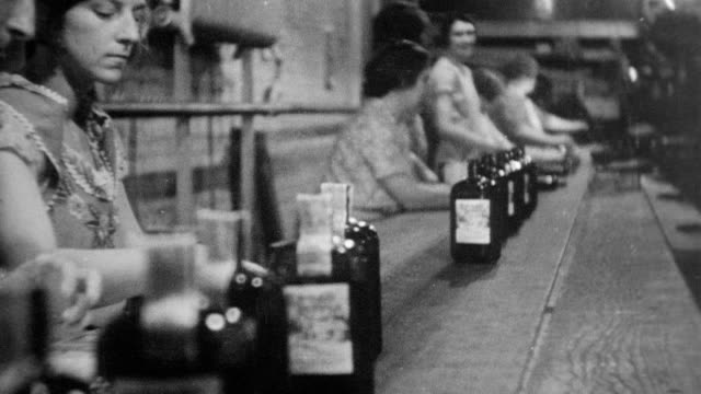 men and women working in a whiskey factory after prohibition repeal / depicts process of creating and bottling the alcohol / alcohol bottles on... - 1932 stock videos & royalty-free footage