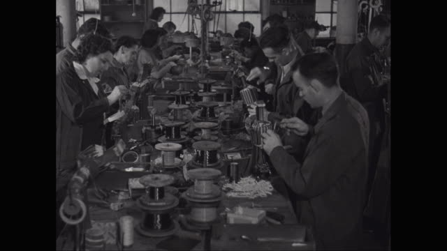 ms men and women working in factory / united states - 1940 stock videos and b-roll footage