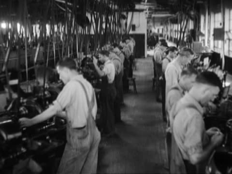 men and women working on a factory assembly line - black and white stock videos & royalty-free footage