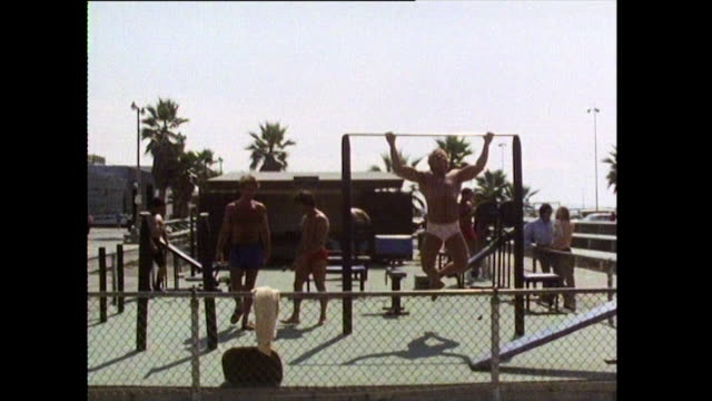men and women workout in swimwear at muscle beach; 1972 - bbc archive stock-videos und b-roll-filmmaterial