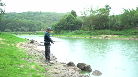 men are catching fishing - freshwater stock videos & royalty-free footage