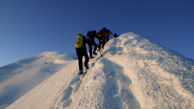 men are climbing to the top of the mountain - clambering stock videos & royalty-free footage