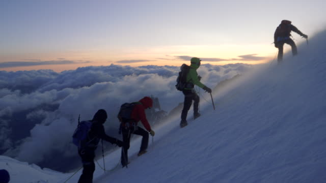 men are climbing to the top of the mountain - winter sport stock videos & royalty-free footage