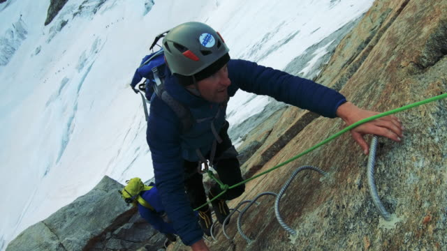 men are climbing to the top of the mountain - conquering adversity stock videos & royalty-free footage