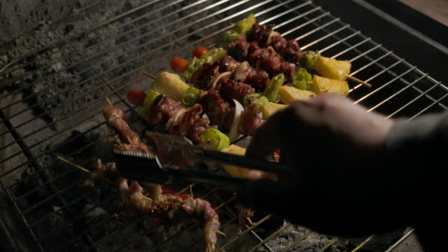 men are grilling bbq grilled pork on the charcoal grill - cherry tomato stock videos & royalty-free footage