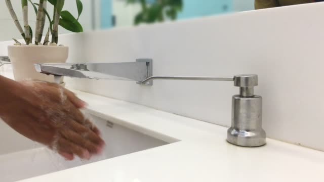 men are washing their hands with liquid soap - soap dispenser stock videos & royalty-free footage