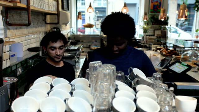 men arranging cups in coffee shop - tidy stock videos & royalty-free footage