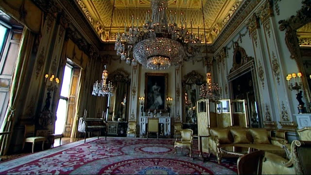 Men arrested after breakin at Buckingham Palace LIB / INT Ornate ceiling TILT DOWN state room in Palace Clsoe shot glass being polished Glass being...