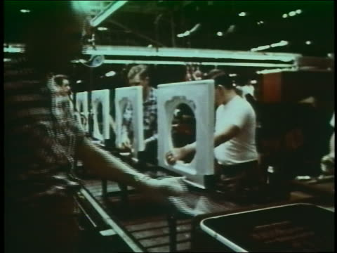 1960 men assembling washing machines on assembly line in factory - anno 1960 video stock e b–roll