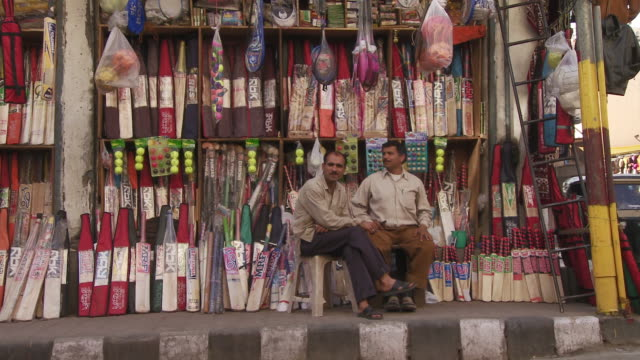 men at cricket bat store - cricket video stock e b–roll