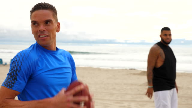 r/f men at line of scrimmage during touch football game on beach - touch football stock videos & royalty-free footage