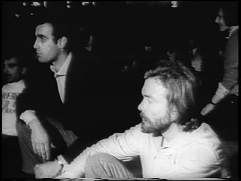b/w 1967 2 men at sitdown antiwar demonstration at night / rome italy / newsreel - anno 1967 video stock e b–roll