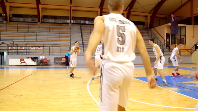 men basketball match - shooting baskets stock videos and b-roll footage