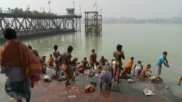 Men bathe at ghats on the Hooghly River in Calcutta.