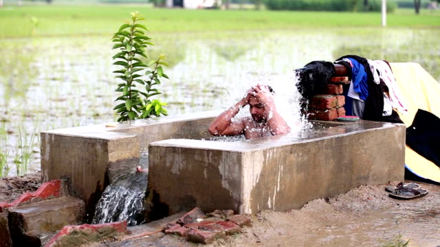 men bathing outdoor - pipe stock videos and b-roll footage
