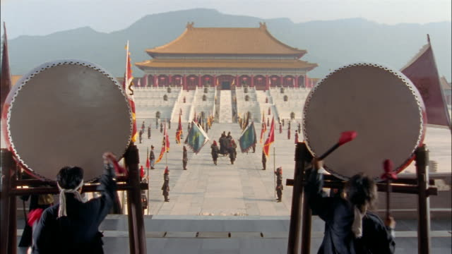 men beat on drums as a procession walks toward the hall of supreme harmony. - forbidden city stock videos & royalty-free footage