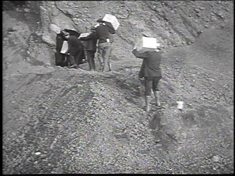 1930 MONTAGE Men blowing up mountainside with dynamite / Volcano, Colorado, USA