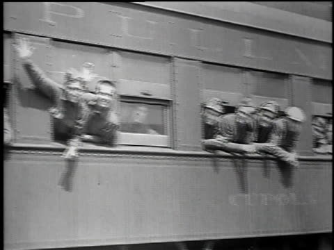men boarding a train / men waving from the train / train traveling past mountains / men getting off the train - 1934 個影片檔及 b 捲影像