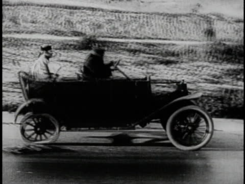 1920 ws men bouncing along in dilapidated car with oval wheels as various parts fall off - larry semon stock videos and b-roll footage