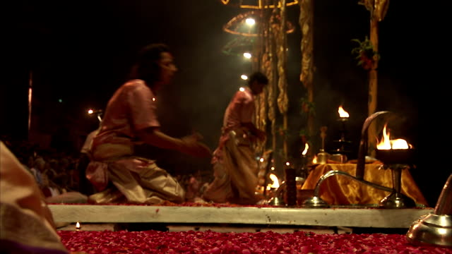 men bow before tables of incense in india. - incense stock videos & royalty-free footage