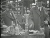 Men break bottles of liquor with hammers during prohibition video id665136063?s=170x170