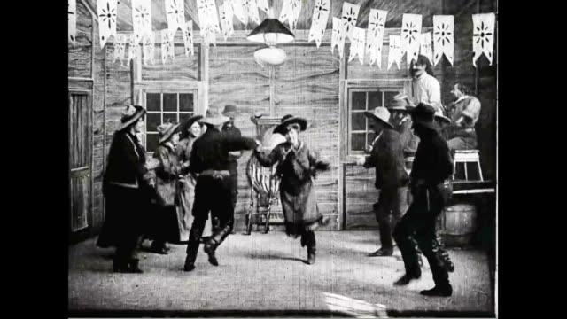 vídeos de stock e filmes b-roll de men bring out guns and shoot them in the air. scene from 'the great train robbery'. - dança quadrada