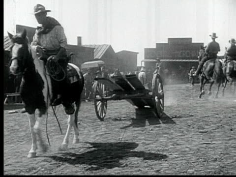 1916 b/w montage ws men building church pulling wooden planks on horse drawn cart / santa monica, california, usa - 1916 stock videos & royalty-free footage