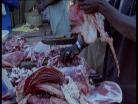 Men butcher meat in Djenne market