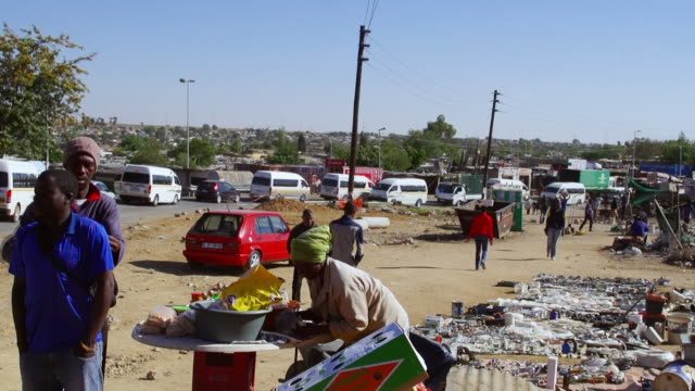 WS Men buying items from street vendor in town / Diepsloot, South Africa