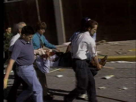men carry a wounded victim of the oklahoma city bombing on a stretcher. - oklahoma city bombing stock videos & royalty-free footage