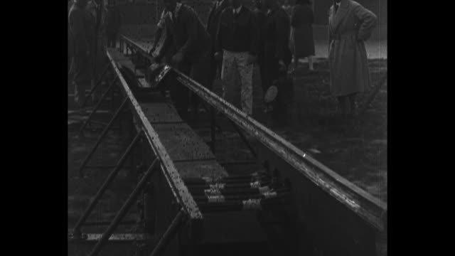 vídeos de stock, filmes e b-roll de men carry aircraft down street / men examine raised rails / men slide gadget for carrying aircraft down rails / men slide aircraft rak.1 down rails;... - 1920 1929