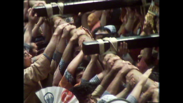 men carry mikoshi through streets at asakusa sanja festival; 1981 - bbc archive stock-videos und b-roll-filmmaterial