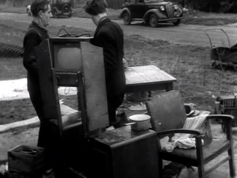 men carry out a television set from a ruined house following the flooding on canvey island 1953 - removal man stock videos & royalty-free footage