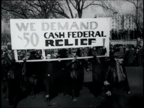 ws men carrying a large banner during a hunger march demanding federal cash relief / united states - unemployment stock videos & royalty-free footage