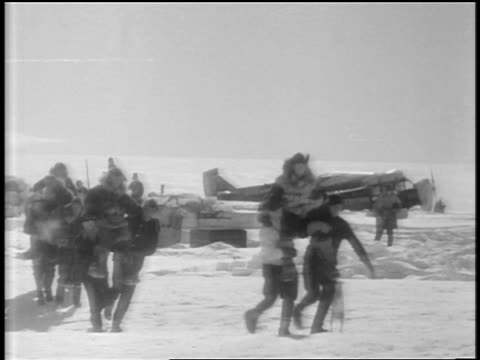 b/w 1929 men carrying admiral byrd others on shoulders toward camera after flight to south pole - carrying pole stock videos & royalty-free footage