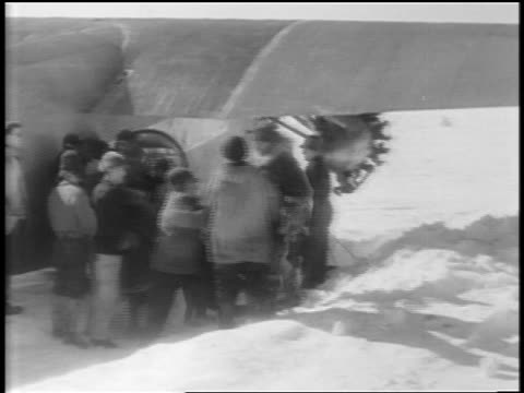 pan men carrying admiral byrd pilot from airplane after flight to south pole / antarctica - carrying pole stock videos & royalty-free footage