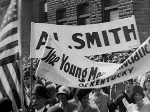 stockvideo's en b-roll-footage met b/w 1920 men carrying al smith banners in parade for reelection campaign / nyc / documentary - al smith