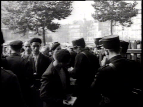 stockvideo's en b-roll-footage met men carrying bundles on shoulders forced labor or deportation ws french gendarmes checking civilian papers at check point world war ii wwii - deportation
